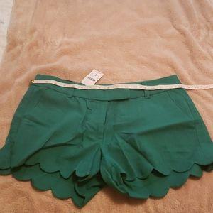 J.Crew emereld green linen scalloped edge shorts.